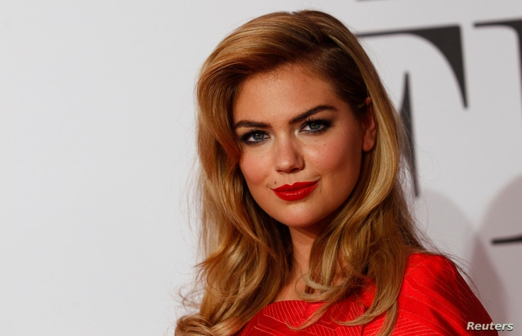 """U.S. actress Kate Upton arrives on the red carpet to promote the movie """"The Other Woman"""" in Munich, April 7, 2014."""