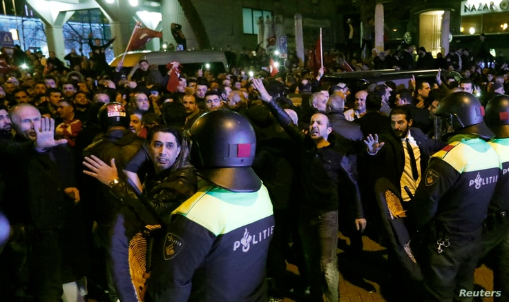 Police start to remove demonstrators outside the Turkish consulate in Rotterdam, Netherlands, March 11, 2017.