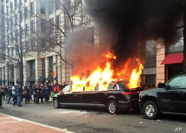 Protesters set a parked limousine on fire in downtown Washington during the inauguration of President Donald Trump, Jan. 20, 2017. Protesters registered their rage against the new president in a chaotic confrontation with police who used pepper spray
