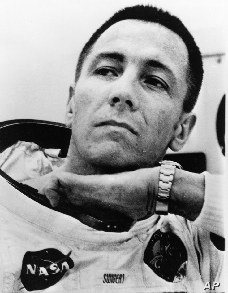 Astronaut John Swigert adjusts something inside his space suit at the Kennedy Space Center Saturday, April 11, 1970, as the Apollo 13 astronauts suited up for their lunar flight. Swigert took the place of Thomas Mattingly as the command module pilot....