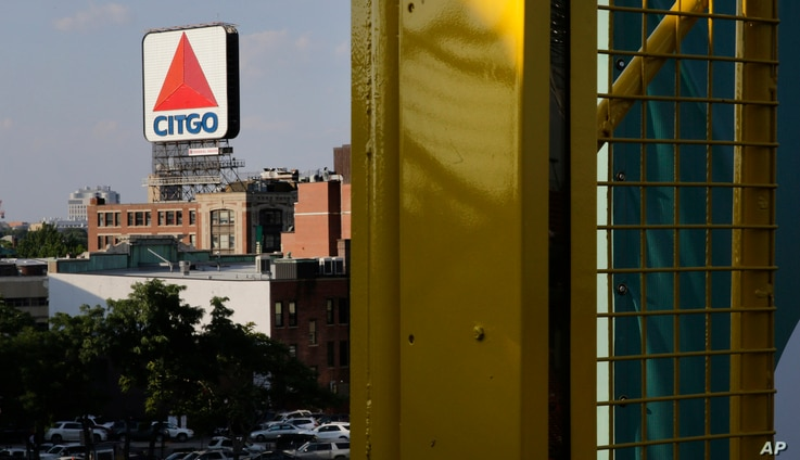 In this July 6, 2016 photo, the iconic Citgo sign is visible from the left field foul pole at Fenway Park in Boston.