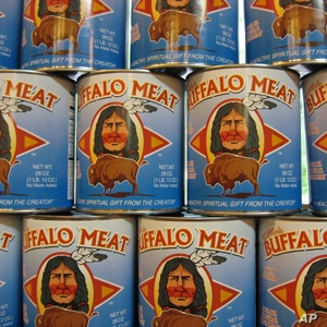 Cans of bison meat on the shelves at the Three Rivers Café and co-op in Indiana.