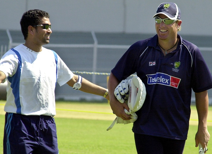 FILE - Sachin Tendulkar, left, shares a laugh with Shane Warne during a 2004 training session in Bombay.