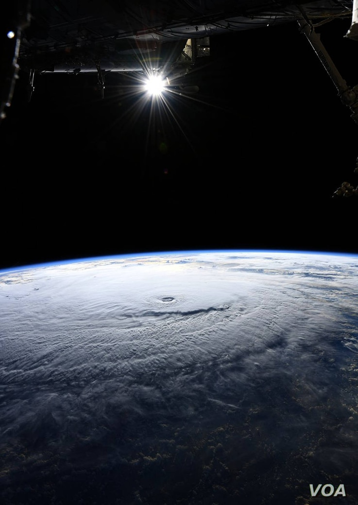 NASA astronaut Ricky Arnold photographs Hurricane Lane near Hawaii in the Pacific Ocean during a flyover from the International Space Station, Aug. 22, 2018.