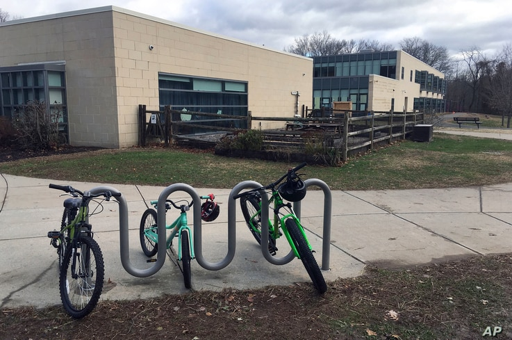 Bicycles are parked outside the Tokeneke Elementary School in Darien, Conn., Nov. 27, 2018.