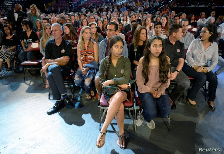 Marjory Stoneman Douglas High School students and parents wait for a CNN town hall meeting to begin, at the BB&T Center, in Sunrise, Florida, Feb. 21, 2018.