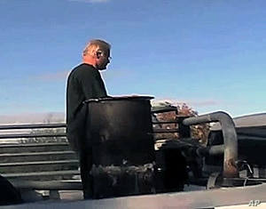 Rick Bates mounted a specialized wood burning stove in the bed of his 1969 GMC truck and connected it to the engine.