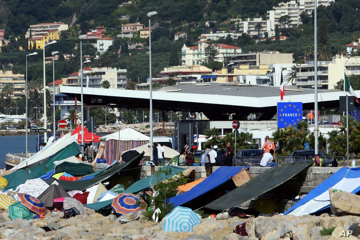 FILE - A camp is set up by migrants, at the Franco-Italian border in Ventimiglia, Italy, June 20, 2015.
