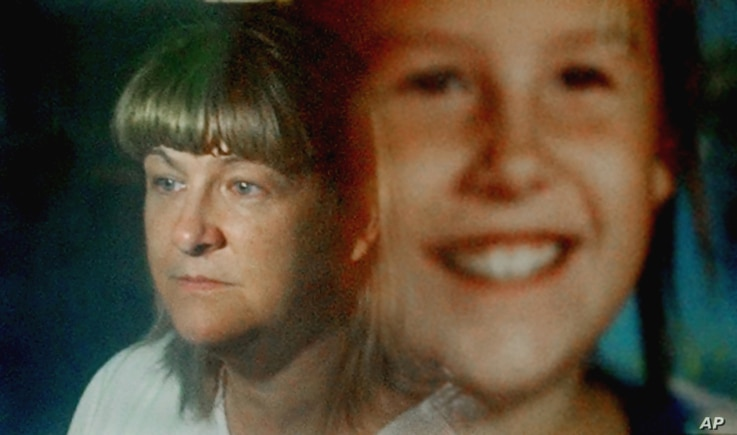 "Maureen Kanka is reflected in a September 1993 photograph of her daughter, Megan, July 22, 2004. She takes comfort knowing her daughter will be forever remembered through ""Megan's Law,"" now in effect in all 50 states."
