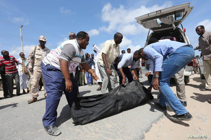 Relatives carry the body of a farmer killed in an attack by Somali forces supported by U.S. troops in the Lower Shabelle region of Somalia, Aug. 25, 2017.