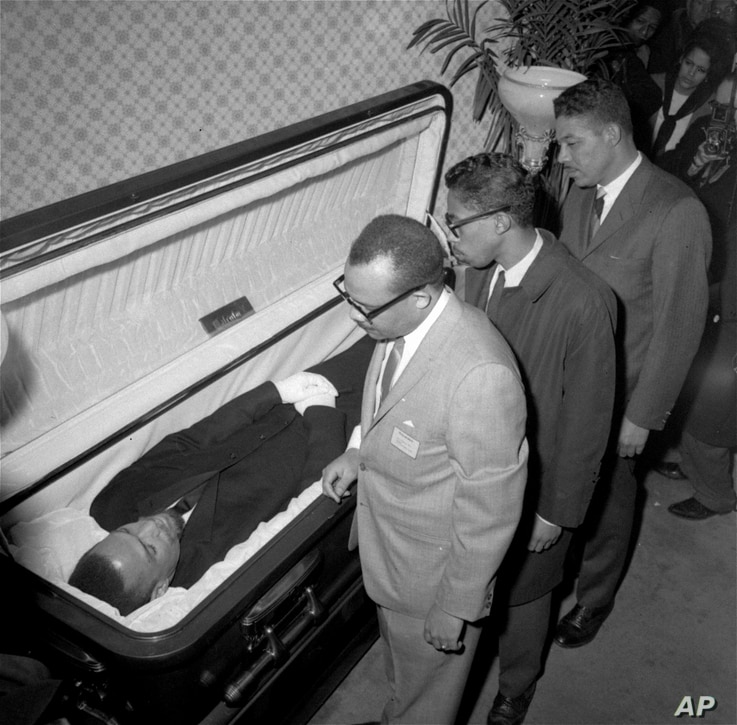 The body of Malcolm X, black nationalist leader who was slain February 21, 1965, at a rally of his organization, is viewed by newsmen at the Unity Funeral Home, Eighth Avenue and 126th Street in New York City February 24, 1965.