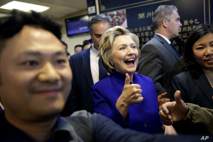 Democratic presidential candidate Hillary Clinton talks with patrons at a restaurant in the Flushing section of Queens in New York, April 18, 2016.