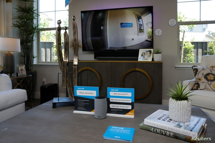 """An Amazon Echo displays a video feed of the front door on a TV in the living room of an Amazon """"experience center"""" in Vallejo, California, May 8, 2018."""