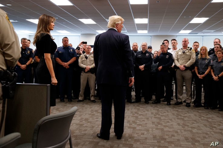 President Donald Trump and first lady Melania Trump meet with first responders at the Las Vegas Metropolitan Police Department, Oct. 4, 2017, in Las Vegas.