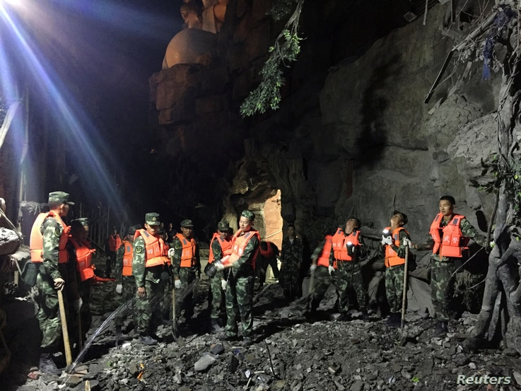 Chinese paramilitary police search for survivors after an earthquake in Jiuzhaigou county, Ngawa prefecture, Sichuan province, China August 9, 2017.