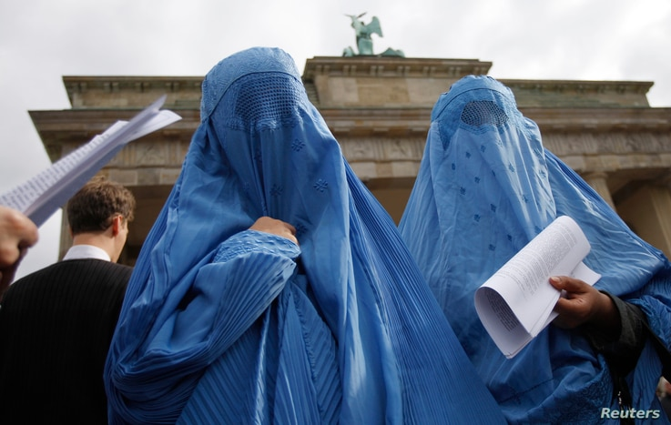 Protesters dressed in burqas attend a rally in front of the Brandenburg Gate, in Berlin, Germany, Sept. 20, 2008. If Germany enacts Merkel's ban, it would join the three other European countries - France, Belgium and the Netherlands - which aleady ha...