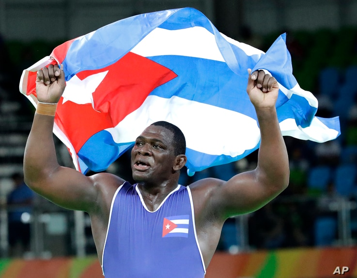 Cuba's Mijain Lopez Nunez celebrates after beating Turkey's Riza Kayaalp to win the gold in the men's wrestling Greco-Roman 130-kg competition at the 2016 Summer Olympics in Rio de Janeiro, Brazil, Aug. 15, 2016.