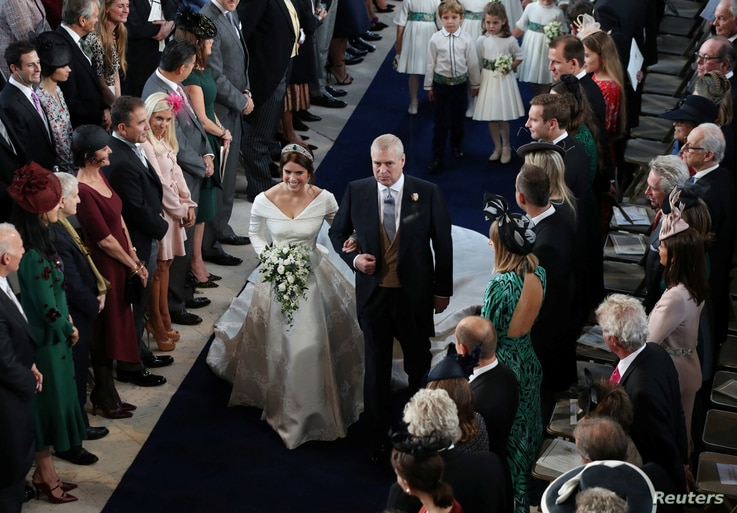 Princess Eugenie walks down the aisle with her father, the Duke of York, for her wedding to Jack Brooksbank at St George's Chapel in Windsor Castle, Windsor, Britain, Oct. 12, 2018.