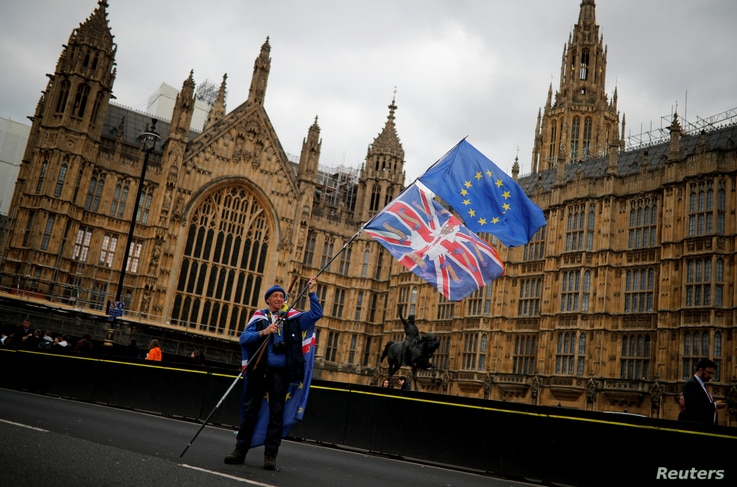 An anti-Brexit protester stands outside the Houses of Parliament, in London, Britain, March 27, 2019.