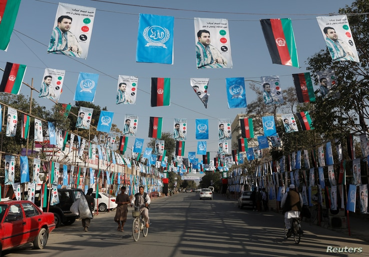 Election posters of parliamentarian candidates are installed during the elections campaign in Kabul, Afghanistan, Sept. 30, 2018. The parliamentarian elections will be Oct. 20, 2018.