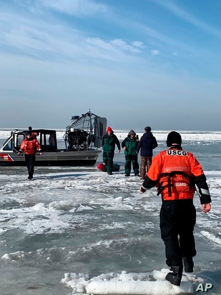 In this photo provided by the U.S. Coast Guard, members from Coast Guard Station Marblehead rescue ice fishermen from an ice floe that broke free from land north of Catawba Island, March 9, 2019, in Ohio. People were rescued by the Coast Guard and lo...