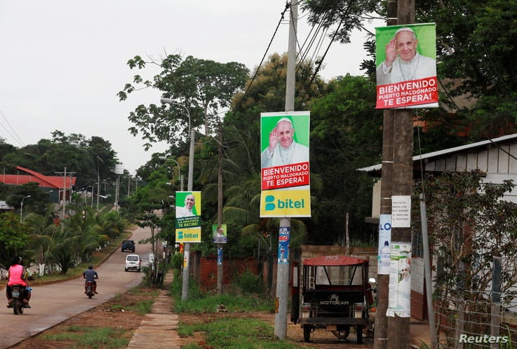Posters of Pope Francis hang on lamp posts along a street in Puerto Maldonado, ahead of the papal's visit to Peru, Jan. 18, 2018.