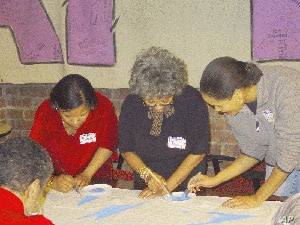 The Names Project Foundation sponsors workshops like this one to help families create AIDS Memorial Quilt panels