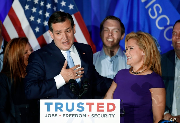 Republican presidential candidate Sen. Ted Cruz, R-Texas, speaks as his wife Heidi listens during a primary night campaign event, April 5, 2016, in Milwaukee.