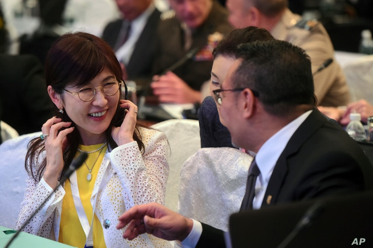 Japan's Defense Minister Tomomi Inada (left) talks with her Malaysian counterpart, Hishammuddin Hussein, ahead of the first plenary session at the 2017 International Institute for Strategic Studies (IISS) Shangri-la Dialogue, an annual defense and se...