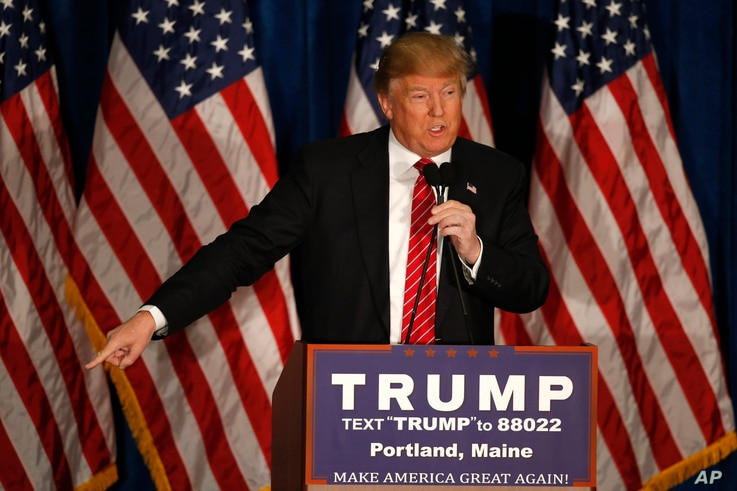 Republican presidential candidate Donald Trump says Mitt Romney had come to him begging for for help during a campaign stop in Portland, Maine, March 3, 2016.