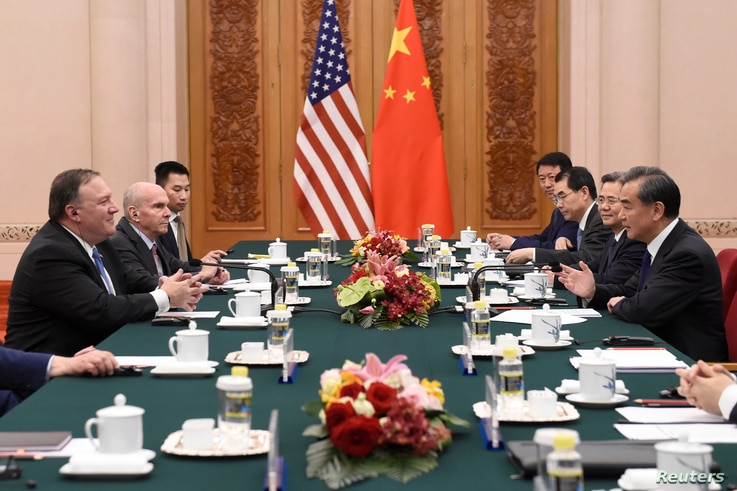 Chinese Foreign Minister Wang Yi, right, meets with U.S. Secretary of State Mike Pompeo, left, at the Great Hall of the People in Beijing on June 14, 2018.