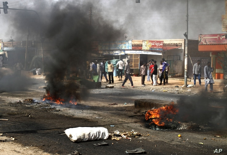 Protesters burn tires and close the highway to northern cities amid a wave of unrest over the lifting of fuel subsidies by the Sudanese government, in Kadro, Sudan, Sept. 25, 2013.