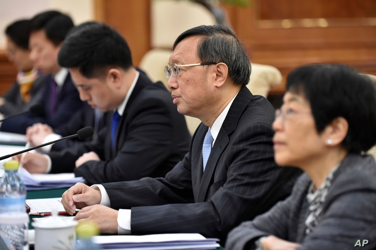 Chinese State Councilor Yang Jiechi, second from right, addresses a speaks a representative of the European Union for Foreign Affairs and Security Policy, during a meeting in Beijing, April 19, 2017.