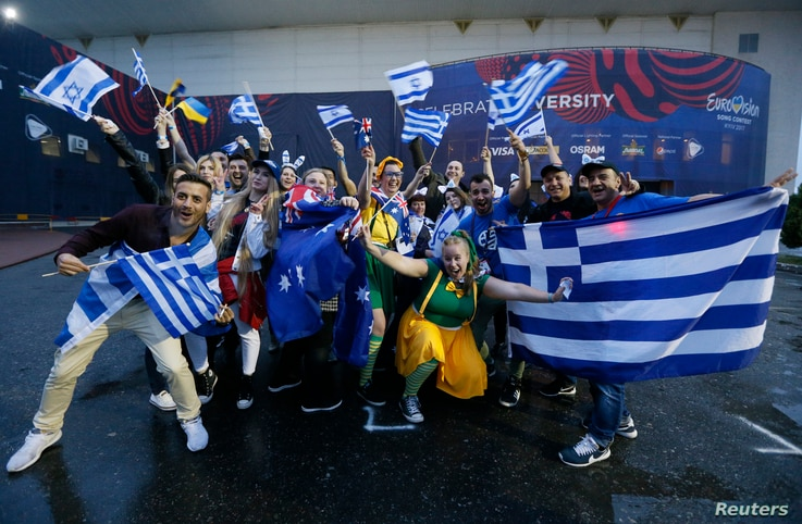 Fans wave flags before the Eurovision Song Contest 2017 Grand Final at the International Exhibition Center in Kyiv, Ukraine, May 13, 2017.