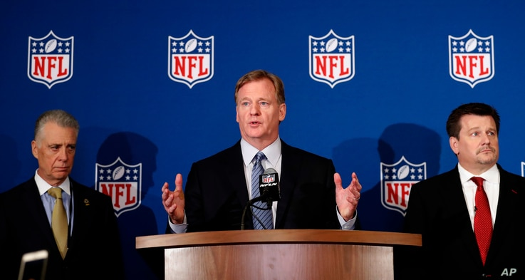NFL commissioner Roger Goodell (C) is flanked by Pittsburgh Steelers president Art Rooney II (L), and Arizona Cardinals owner Michael Bidwill during a news conference where he announced that NFL team owners have reached agreement on a new league poli...