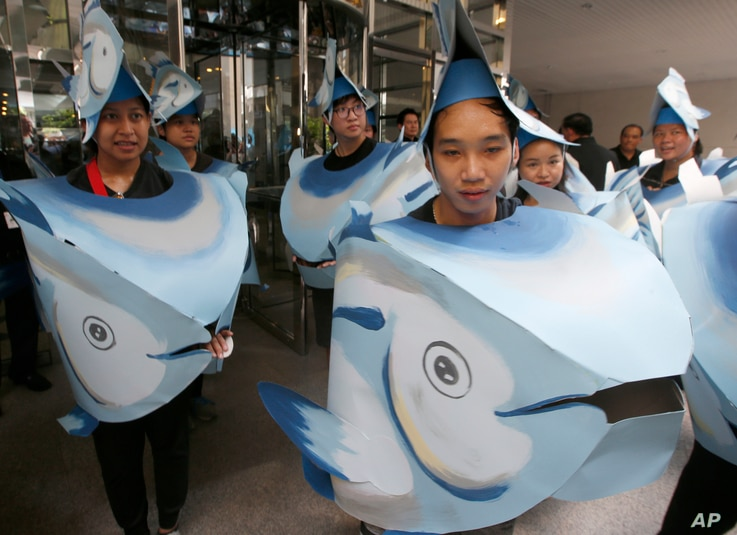 FILE - Greenpeace activists in tuna head costumes gather in front of the Thai Union headquarters in Bangkok, Thailand, June 2, 2017. Greenpeace is campaigning against Thai Union's destructive fishing practices and in favor of improving conditions for...
