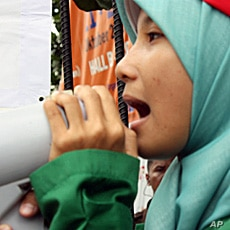 A junior high school student protesting outside the World Tobacco Asia 2010 exhibition in Jakarta.