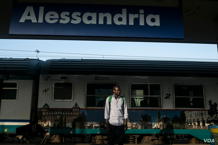 "Every morning, Abdul Adan takes a 20-minute train ride to Alessandria, Italy, where he works with bee hives and in an organic garden to sell produce, Aug. 22, 2017. ""I feel very lonely, very very,"" he says."