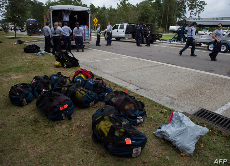 Members of the Missouri Search and Rescue, part of FEMA, unload their gear at a staging area as Hurricane Florence starts to make landfall in Leland, North Carolina, Sept. 13, 2018.