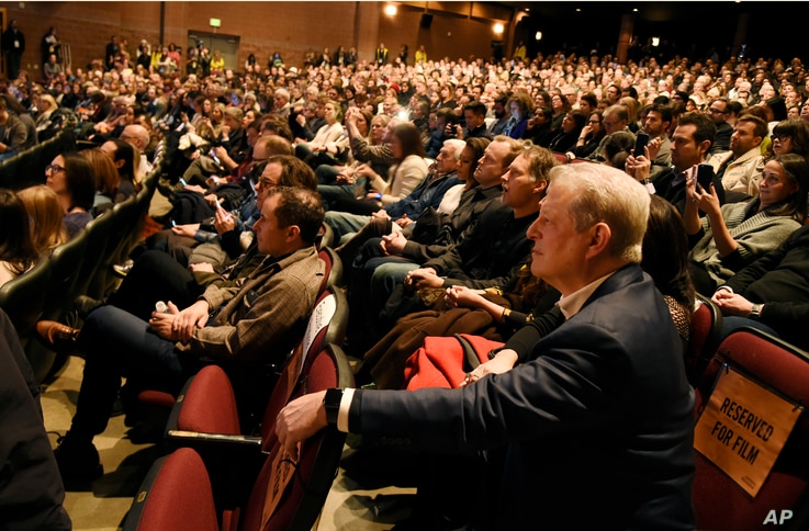 """Former Vice President Al Gore, right, listens to introductory remarks for the film """"An Inconvenient Sequel: Truth to Power,"""" at the premiere of the film, Jan. 19, 2017, in Park City, Utah."""