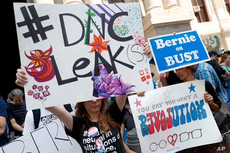 Demonstrators make their way around downtown, July 25, 2016, in Philadelphia, during the first day of the Democratic National Convention.