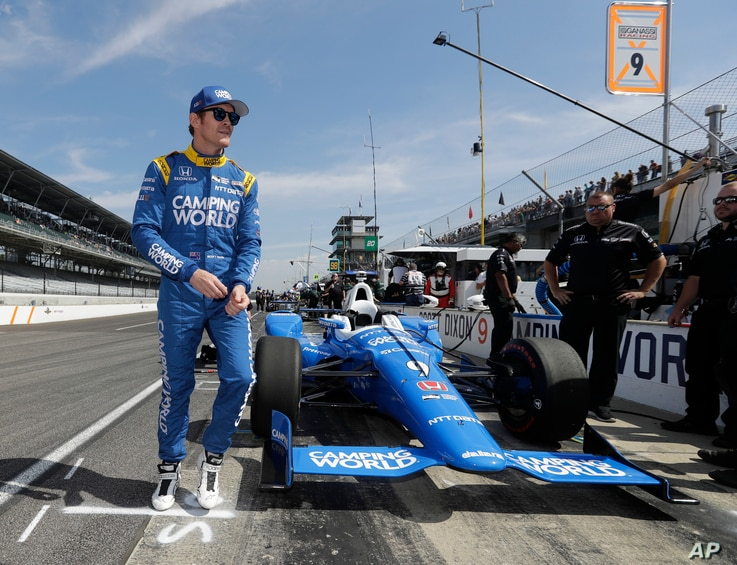 Scott Dixon, of New Zealand, walks to his pit box during the final practice session for the Indianapolis 500 auto race at Indianapolis Motor Speedway, May 26, 2017.