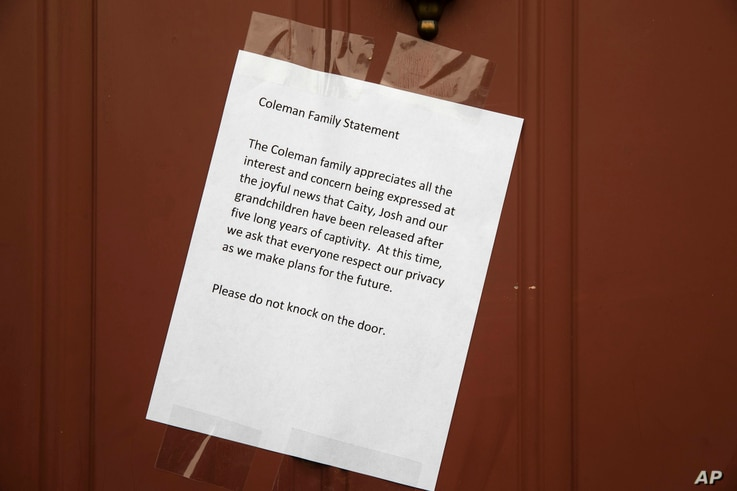 A message from Jim and Lyn Coleman is posted on their home in Stewartstown, Pa., Oct. 12, 2017. The Coleman's daughter Caitlan Coleman, her Canadian husband and their three young children have been released after years held captive by a group that ha...