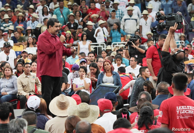 Venezuela's President Nicolas Maduro, left, speaks during a gathering in support of him and his proposal for the National Constituent Assembly in Caracas, Venezuela, June 27, 2017.