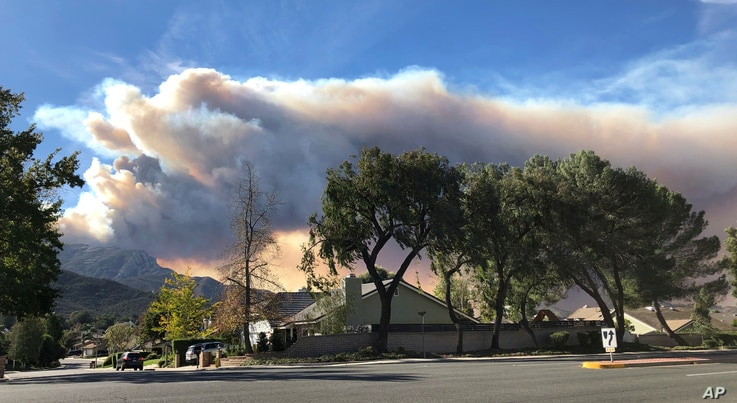 A large wildfire plume from a recent flareup near Lake Sherwood, Calif., is visible from Thousand Oaks, Calif., Nov. 13, 2018.