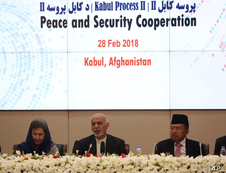 FILE - In this Wednesday, Feb. 28, 2018 file photo, Afghanistan's President Ashraf Ghani, center, speaks during the 2nd Kabul Process conference at the Presidential Palace in Kabul.