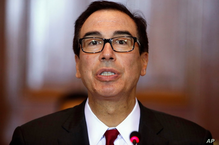 FILE - Treasury Secretary Steve Mnuchin leads a meeting of the Financial Stability Oversight Council at the Treasury Department in Washington, Oct. 16, 2018.