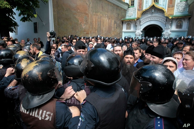 Riot police surround the Kyiv Pechersk Lavra, an Orthodox Christian monastery, where radical activists were protesting separatists, June 22, 2014.