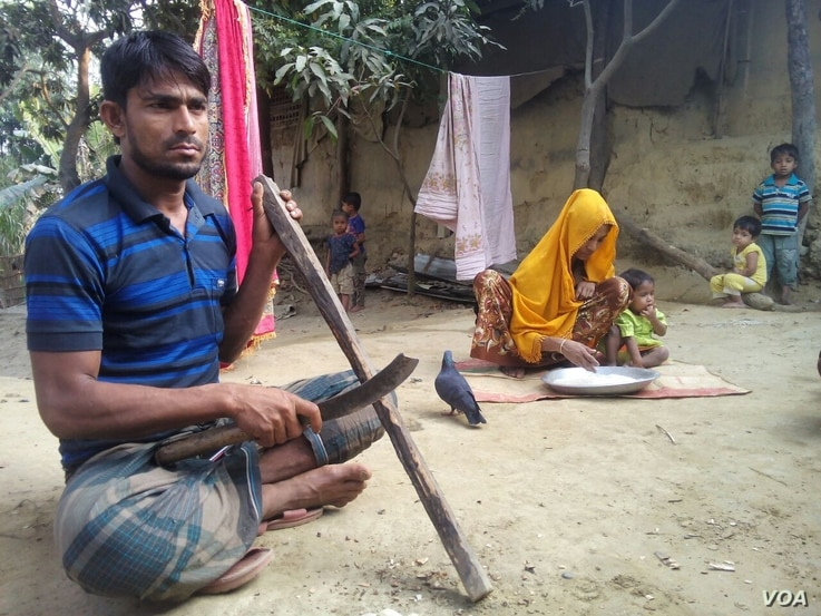 Rohingya refugee man Dil Mohammad, 30, with his wife and three of their children at a Rohingya colony in Cox's Bazar, Bangladesh. During military crackdown in Rakhine, Mohammad fled to Bangladesh with his family. He says he would never return to Myan...