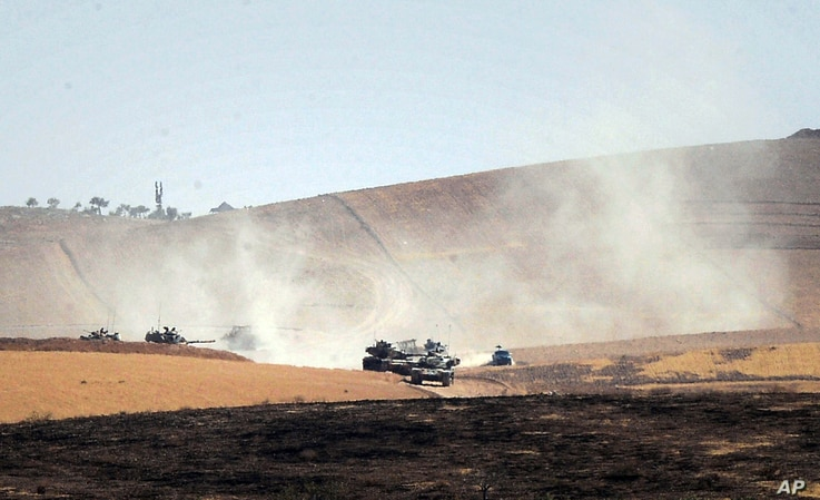 Turkish military move inside Syria near the Turkish border town of Karkamis, Turkey, Friday, Aug. 26, 2016.